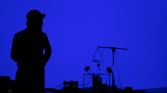 Kanta Horio in silhouette against a blue screen