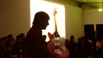 Lee Ranaldo holding a guitar at DCA Dundee
