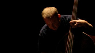 Werner Dafeldecker playing a double bass
