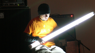 Atsuhiro Ito holding a glowing fluorescent tube