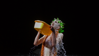 Sgaire Wood performing with water at EPISODE 9