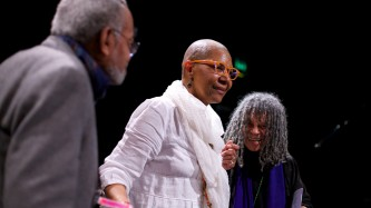 M NourbeSe Philip is congratulated by Amiri Baraka and Sonia Sanchez