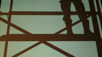 An image of someone's legs and a platform in silhouette