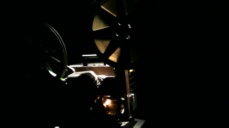 A projector running in a dark room