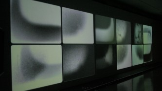 twelve rectangular images projected on a long screen