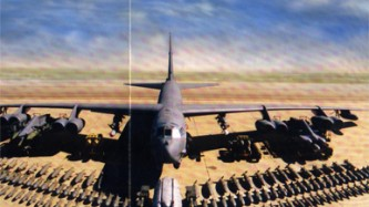 A scanned picture of a B-52 and its ordinance laid out in the desert