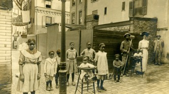 An old photograph of a group looking direct to camera