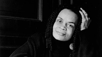 A medium shot black & white portrait of Sonia Sanchez, head leaning on hand