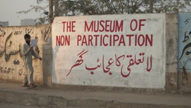 The Museum of Non Participation written on a wall in English and Arabic
