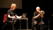 Klaus sits at a table and plays electronics whilst Radu plays trombone