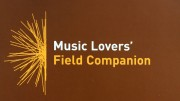 Brown background yellow starburst design and text Music Lovers' Field Companion