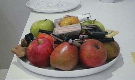 A pile of fruit in a bowl on white counter