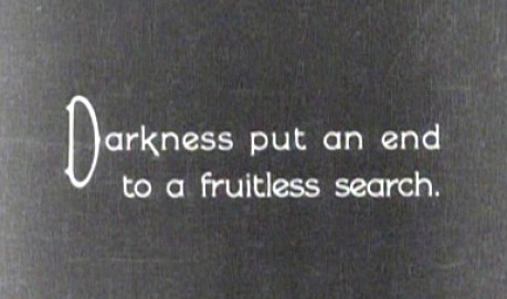 """A title from a a silent film reads """"Darkness put an end to  fruitless search"""""""