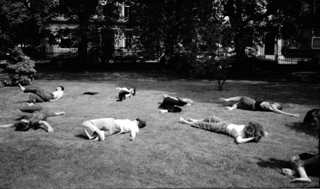 People lying on the grass in a park