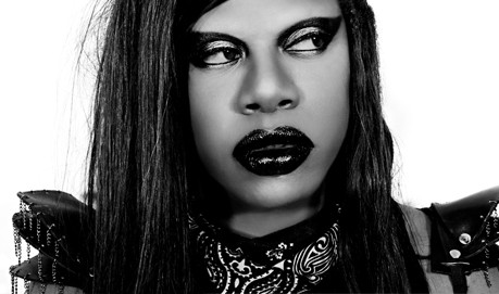 A B&W shot of M Lamar wearing leather and heavy make-up
