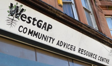 A sign outside a shop that reads Westgap community advice