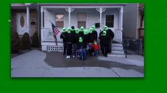 screen shot on a green desktop, of a group of people wearing green balaclava