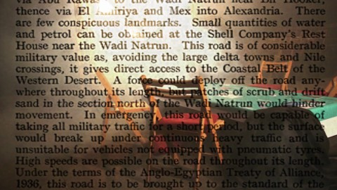 Overlayed image of blown-up newspaper text and a green table with wooden chairs