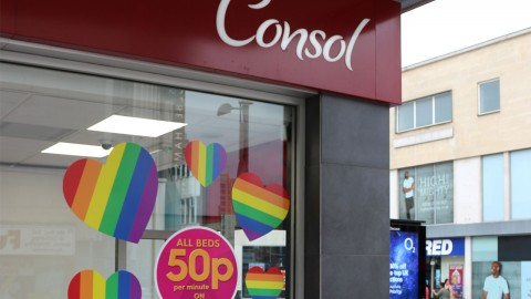 Rainbow pride heart window decals advertise an offer at a Sunbed shop, Consol