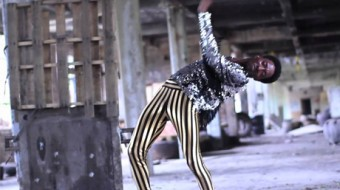 Storyboard P bend as he dances in a sequin top and gold leggings