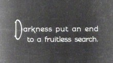 "A title from a a silent film reads ""Darkness put an end to  fruitless search"""