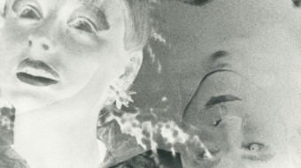 Two ghostly faces, black and white, negative and solarised float in the frame