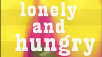 """White text on a yellow and pink film still reads """"Lonely and Hungry"""""""