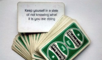 "A pack of cards is spread out, 1 says ""Keep yourself in a state of not knowing"""